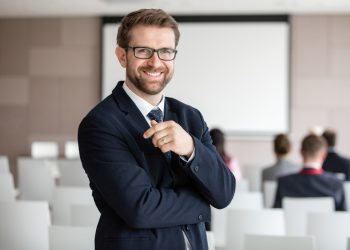 portrait-of-cheerful-young-business-man-in-office